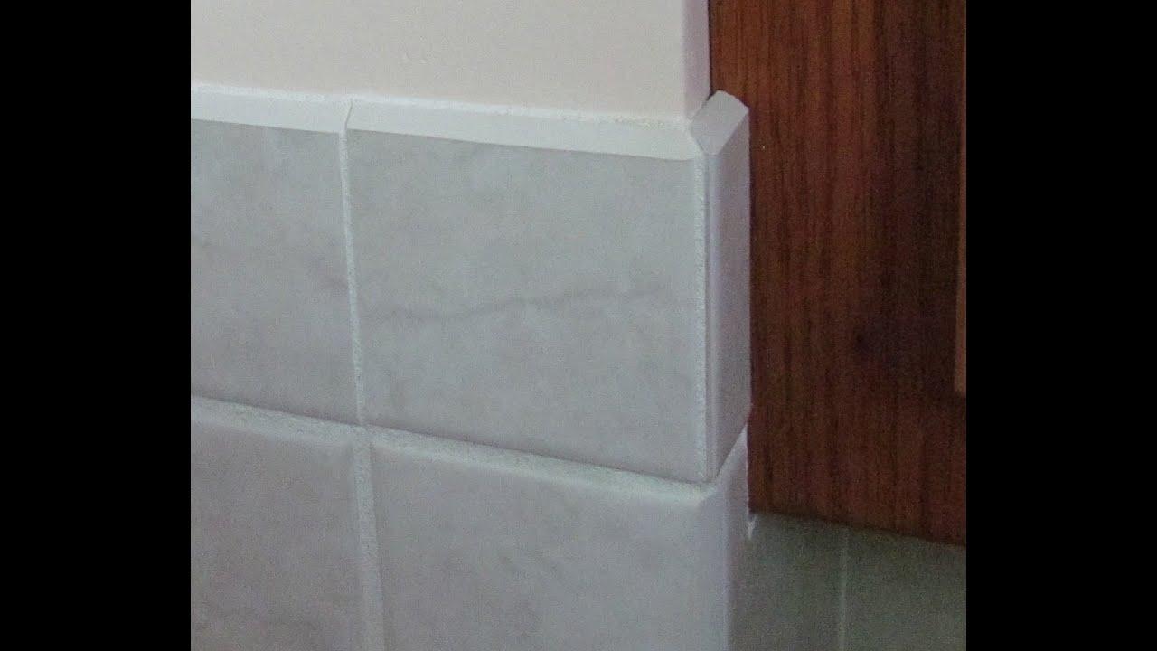 making vertical miter cuts in ceramic tile trim using a sander