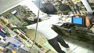 crazy robbery caught on video store clerk offers robber cigarettes during armed holdup