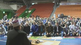 Bosnia supporters pray ahead of their World Cup qualifier against Lithuania