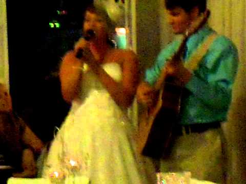 Bride Erica Singing Heavenly Day to David (groom) at their Wedding