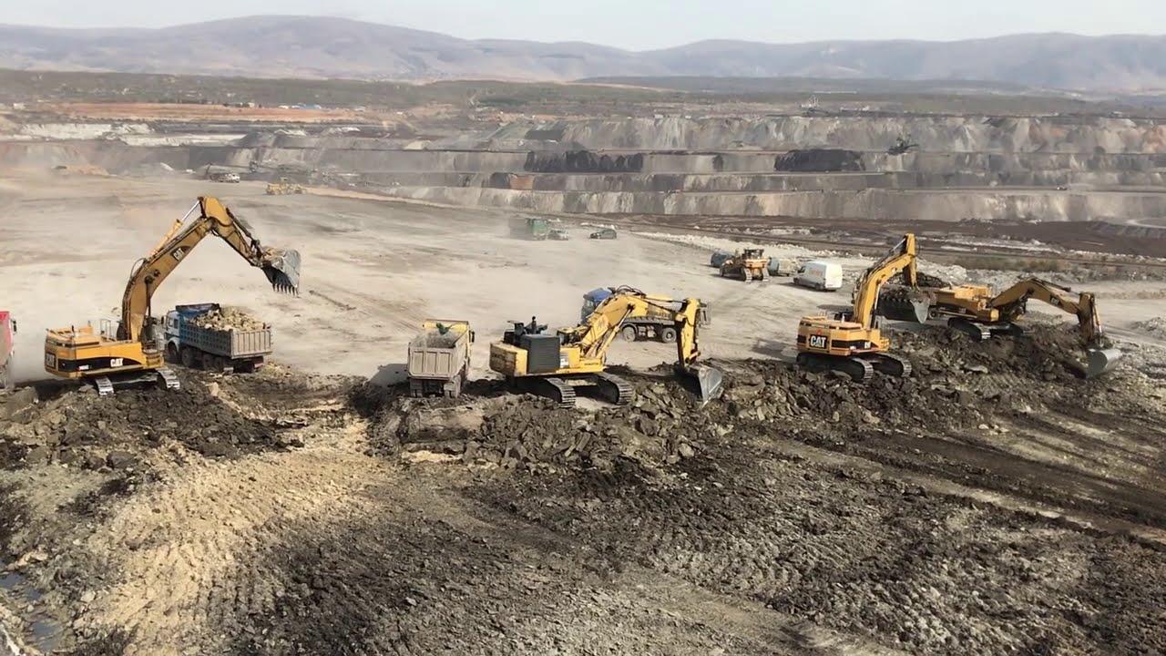 Caterpillar 365C Excavators And Komatsu PC800 Loading Trucks