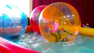 Giant WATER BALLS in a pool POOL BALLS - Fun activities for Kids and Toddlers