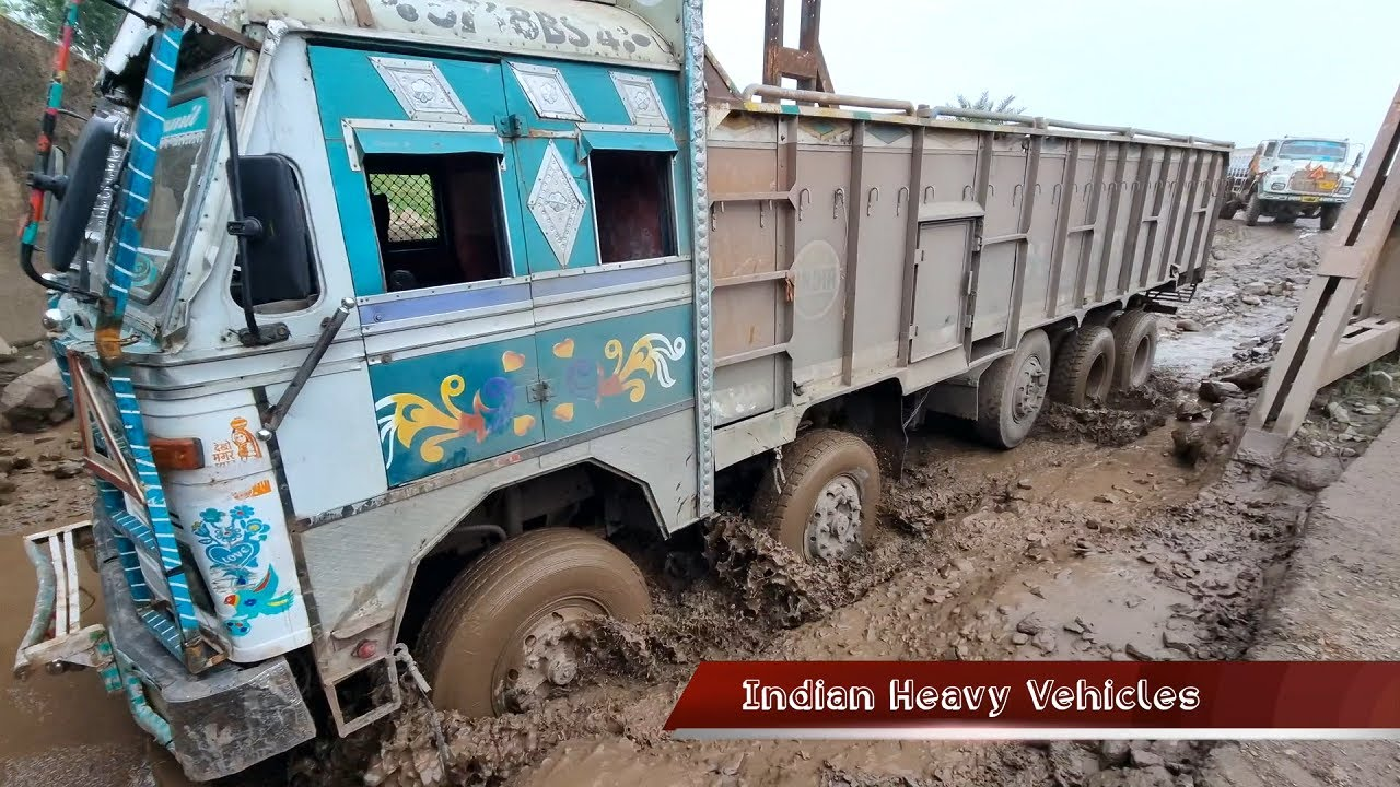 Deadly Road #11 | Ashok Leyland and Tata trucks are running on the waterlogged road under the bridge