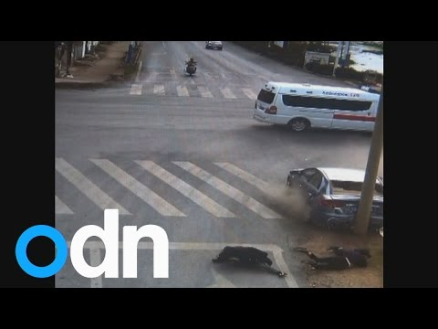 GRAPHIC CONTENT: Car smashes into pedestrians, and somehow they survive