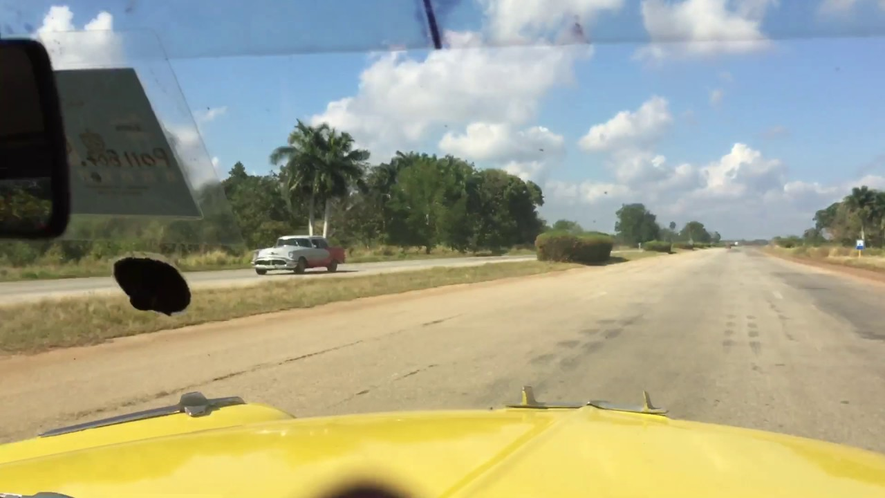 Driving on Chevrolet 1957 from Santa Clara to Havana Cuba