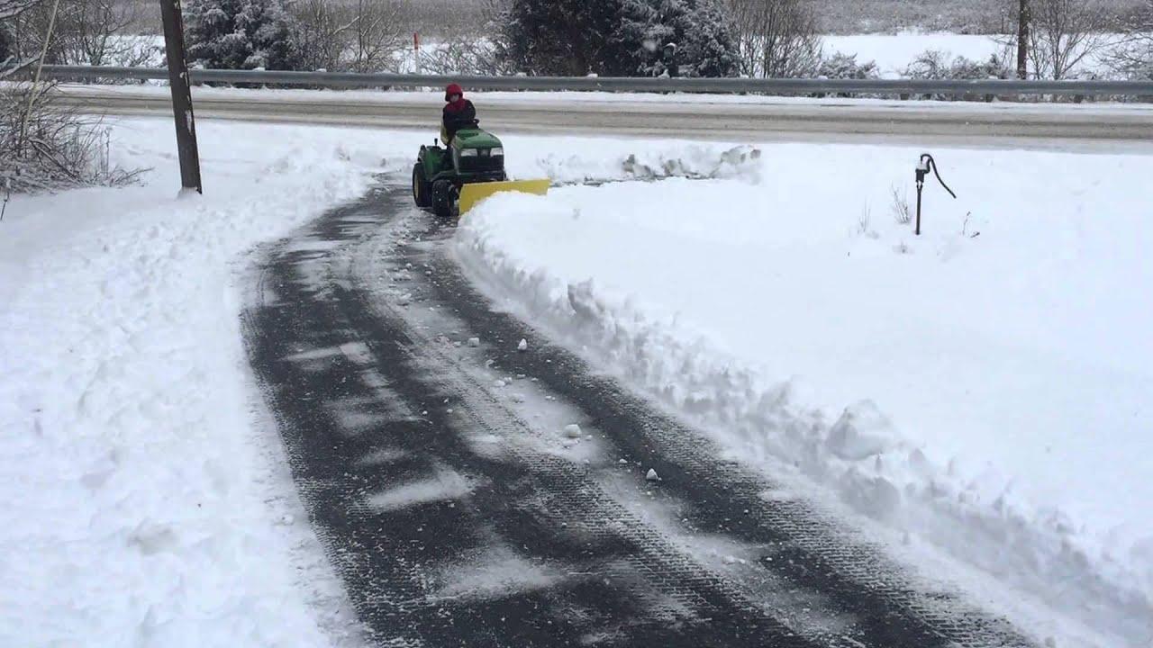 John Deere 116 Snow Plow : John deere tractor plowing snow youtube