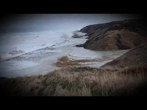 Horden Beach. Storm surge with high tide makes the sea reach cliffs cliffs.