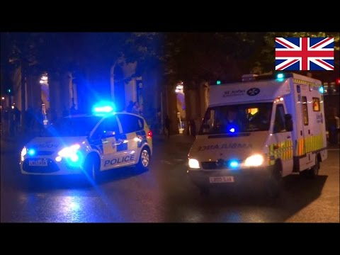 Ambulance & police car responding with two tone sirens - BTP & SJA