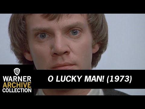 O Lucky Man! (1973) – Malcolm McDowell