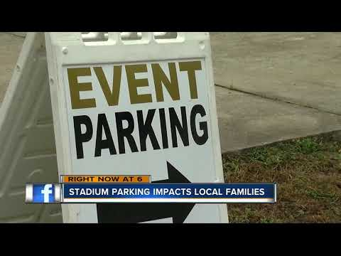 Local families consider parking opportunities for games at Raymond James stadium a blessing