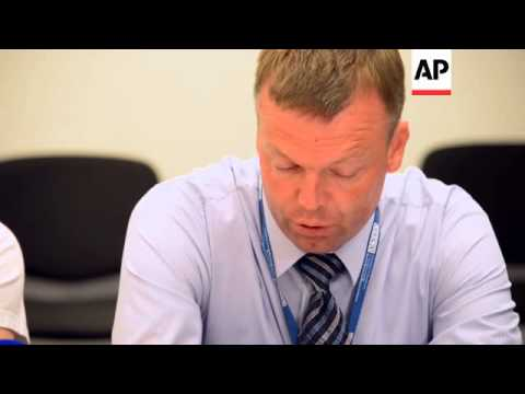 OSCE team returns from MH17 crash site, news briefing; Dutch/Australian police comment