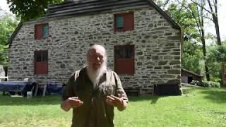 Rudy Christian, master carpenter and timber framer, details restoration work on Jean Hasbrouck House