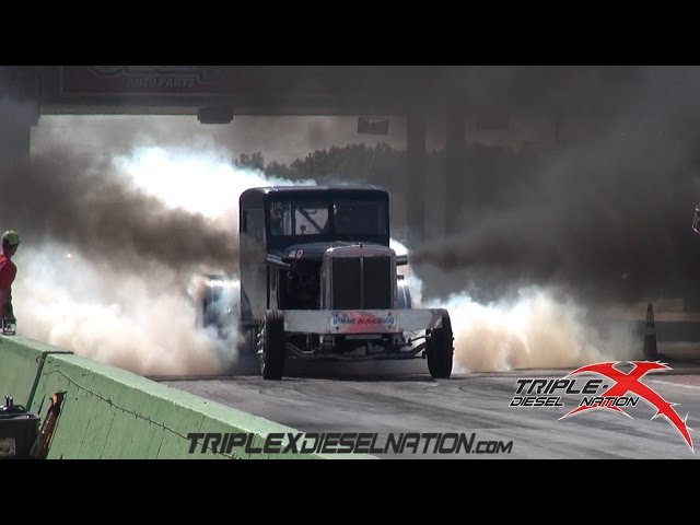 BIG RIGS BATTLE IT OUT ON THE DRAG STRIP!!