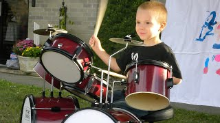 avery molek 3 year old drummer at daycare show