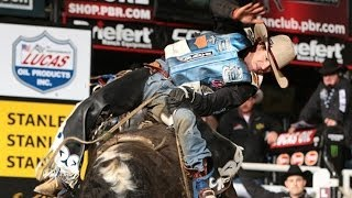 WRECK: David Scott Mason takes a hit in the chute from Hustle Up (PBR)