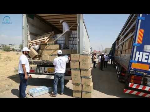 Distributing aid at Bardarash 17th September 2014