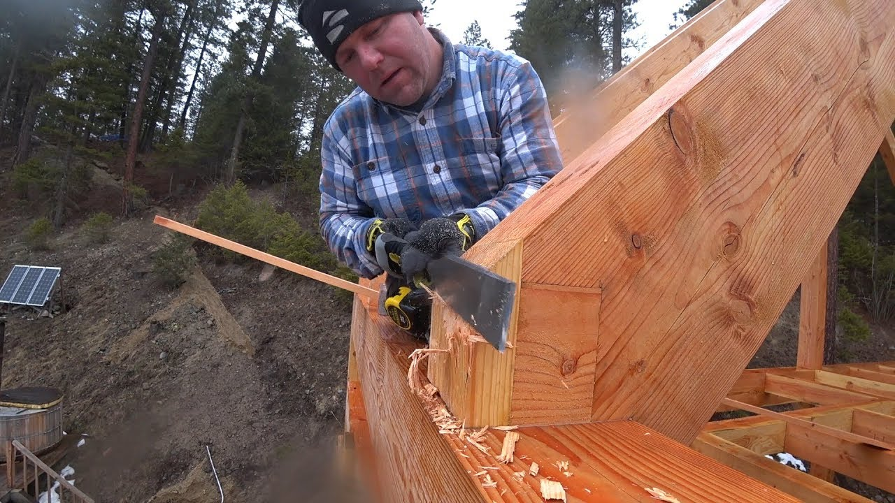chiseling-from-30-feet-up-timber-frame-ledger-board-install
