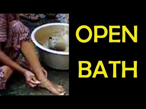 Girls Bathing on open road using best body soap