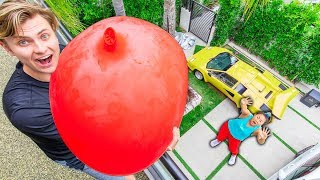 Download DROPPING 100LBS WATER BALLOON ON HER!! (GONE WRONG) Mp3 and Videos