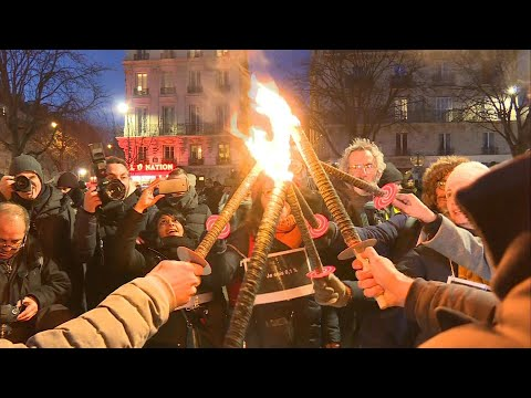 AFP News Agency: French union holds torch-lit protest in Paris against pension reform | AFP