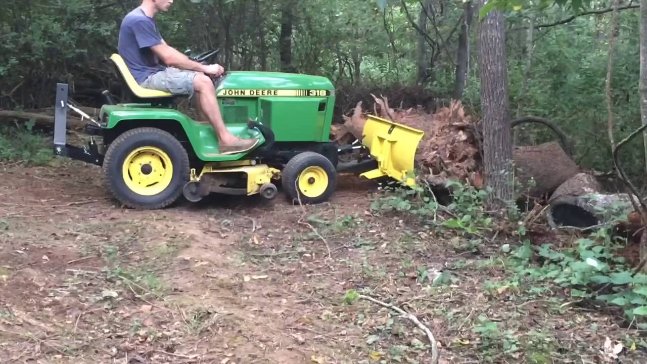 Pushing Logs with the John Deere 318 and 54