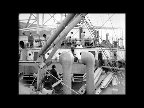 Merchant ship Canadian Raider loading lumber in Vancouver in January 1920