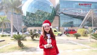 بالفيديو - ''سانتا كلوز'' يوزع الهدايا والبسمات على أطفال 57357