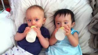 Twin babies drinking milk after nap