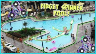 JAYLA AND AYDAH DIVE INTO A 100FT FIDGET SPINNER POOL!! WILL THEY SURVIVE?!