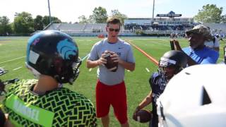 Eli Manning teaches youth QBs