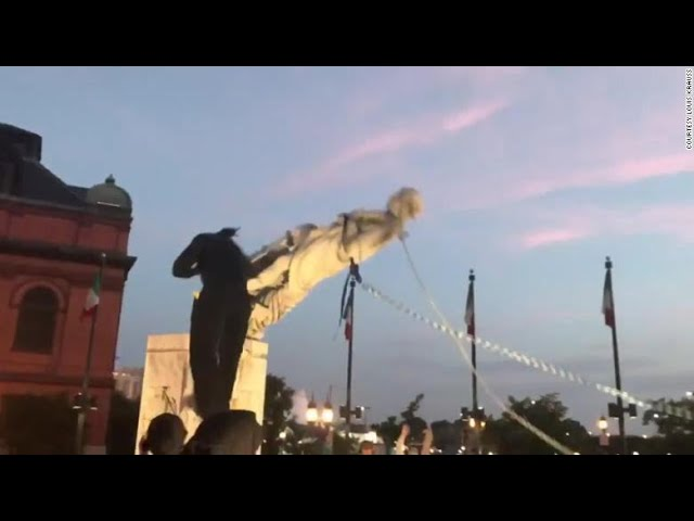 Baltimore Protestors Topple Christopher Columbus Statue & Throw it Into the Harbor