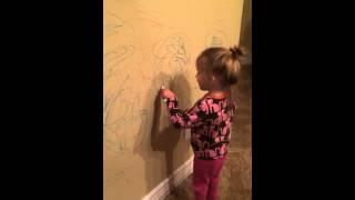 Toddler draws spider dog
