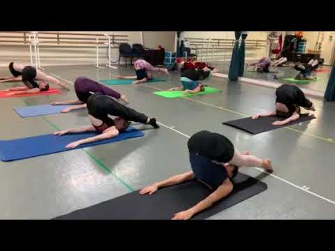 Dance students performing Pilates with Anna