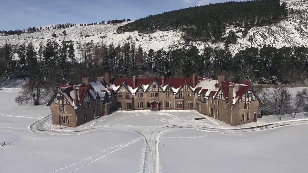 Aerial HD view of Mar Lodge Estate, Braemar, Scotland, after snowfall