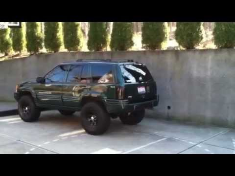 98 jeep grand cherokee laredo w flowmaster lifted youtube. Black Bedroom Furniture Sets. Home Design Ideas