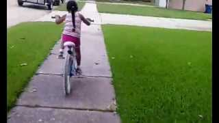 5 yr old rides bike without training wheels!!!
