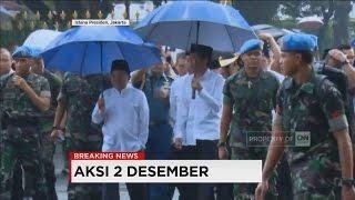 Jokowi - JK dengan Payung Tembus Hujan, Ikut Shalat Berjamaah di Monas