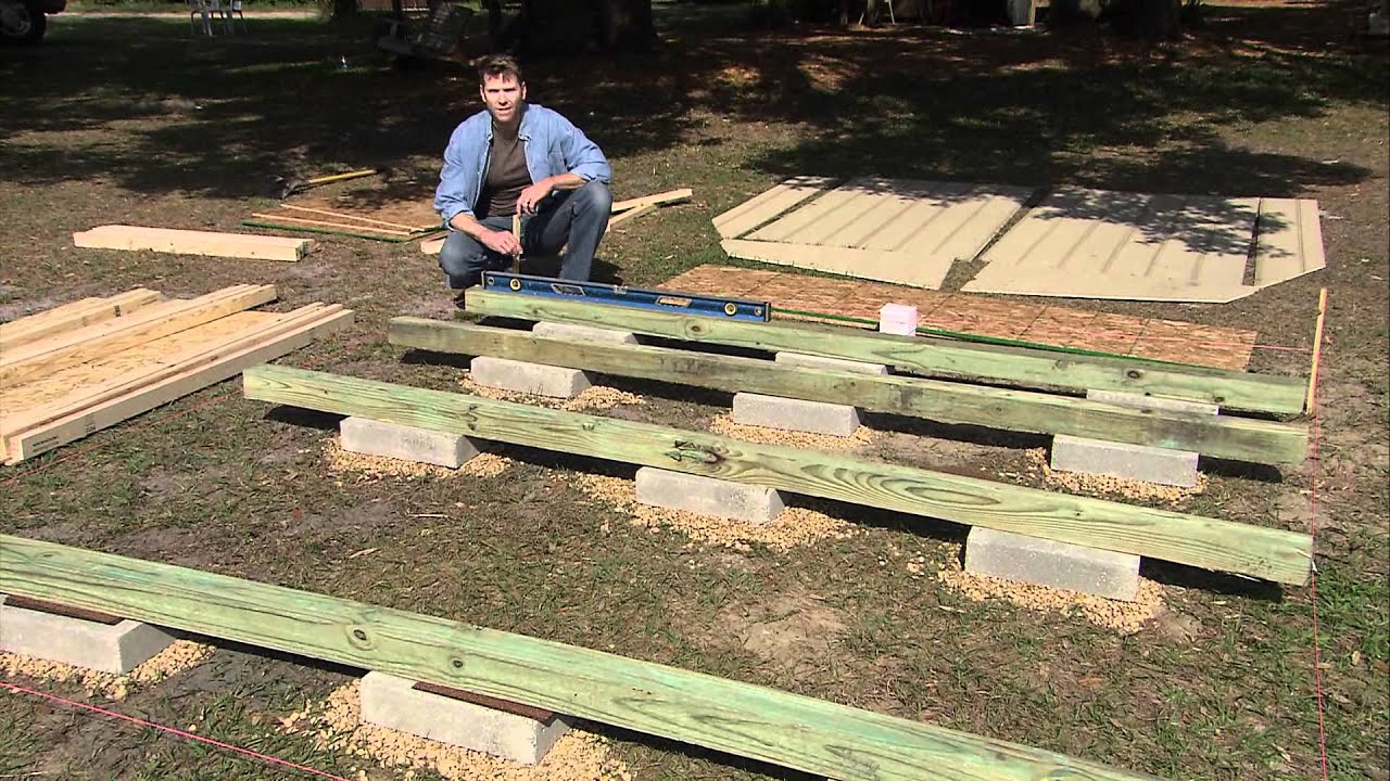 How to level a shed by heartland sheds youtube for How to build a floor for a house
