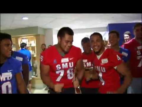 SMU football players sing at children's hospital