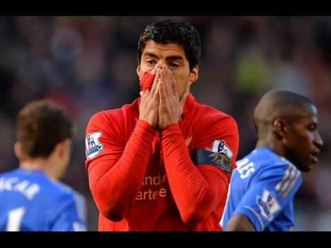 FIFA charges Suarez in biting incident