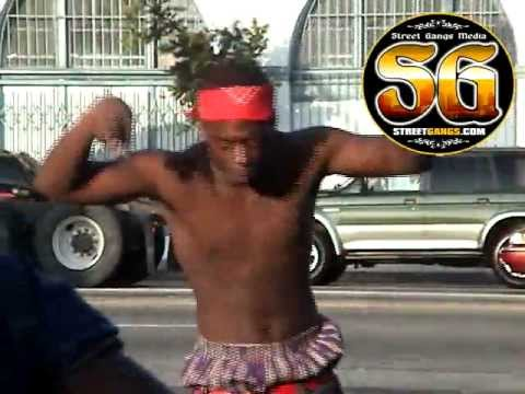 Blood gang member doing dance in South LA after funeral