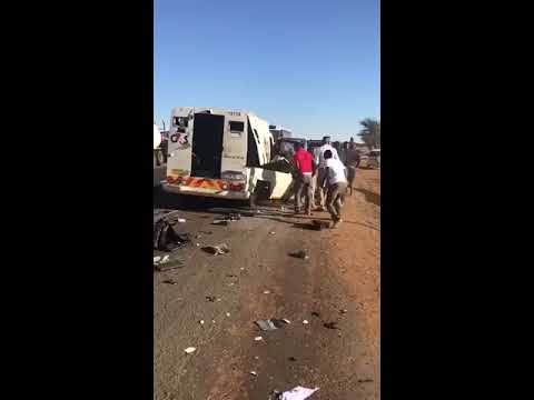 People help themselves with scattered cash after a cash-in-transit heist