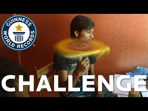 Endurance Challenge - Longest time spinning a Guinness World Records book on the finger