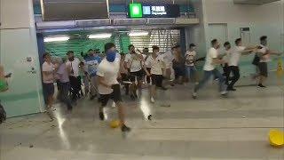 Masked assailants attack democracy activists in Hong Kong subway station