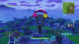 Search between a Bench Ice Cream Truck and Helicopter Fortnite Week 4 Battlestar Location Guide