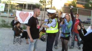 Female officer spreading peace and love instead of hate and violence