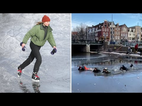 Amsterdam skaters fall through ice into frozen canal before being rescued