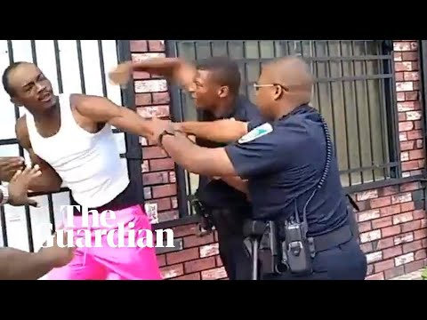 Baltimore police officer resigns after being filmed beating man