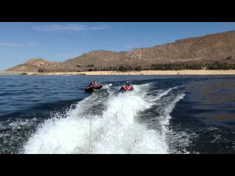 Tubing Behind Our Pontoon: Two tubes, four teens