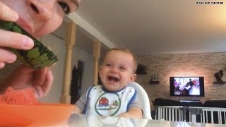 Hahaha! Mommy eating fruit has baby in stitches!